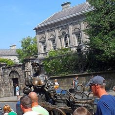 """.🎶...as she wheeled her wheel-barrow, through streets broad and narrow, crying """"four in a row, alive, alive, oh!!"""" 🎶 😄 ..Dublin's statue of Molly Malone pictured here in her original spot at the bottom of Grafton Street. 'The Tart with the Cart' as she's sometimes called is now situated nearby outside St.Andrew's Church on Suffolk Street, definately a more accessible spot to see her. . . #mollymalone #instadublin #visitdublin #graftonstreet #lovindublin #irish #dublin #igersdublin… Molly Malone, Visit Dublin, Grafton Street, Wheelbarrow, The Row, Tart, Crying, Irish, The Outsiders"""