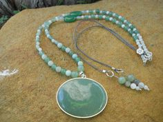 Amazonite, adventurine and moonstone necklace with adventurine and sterling silver pendant. Back decoration detail in adventurine, labradorite and moonstone. $78 (NL20). www.feeko.co.za