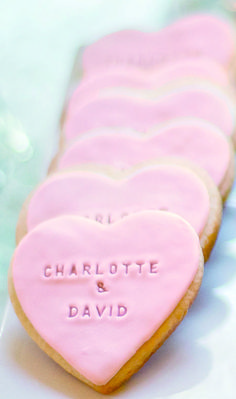 Super cute and easy DIY Wedding Favor Cookies; just stamp your names in once the frosting is set up, but not yet hard
