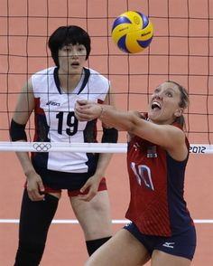 Jordan Larson controls the ball as South Korea's Kim Hee-jin watches during a women's semifinal volleyball match.