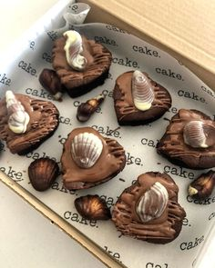Oh my goodness! It's a birthday brownie box with Guylian 😱😍  Order your very own or see our range of toppers available in our bake shop