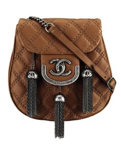 American Millionairess / karen cox.  CHANEL Light Brown Leather Bag with Silver Metal Pompoms,