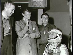 Gus Grissom chuckles during Liberty Bell 7 pre-launch tasks, as fellow Mercury astronaut Gordo Cooper (center) looks on. Photo Credit: NASA