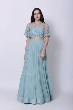Aqua blue bell sleeved blouse with intricate floral embroidery over the net and pleated skirt with chanderi border around the hem. The dress is paired with a dupatta with embroidery. Netted Blouse Designs, Half Saree Designs, Blouse Back Neck Designs, Bridal Blouse Designs, Sabyasachi Lehenga Bridal, Floral Lehenga, Lehenga Skirt, Indian Wedding Outfits, Indian Outfits