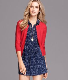 cute navy blue spotty dress with red cardigan