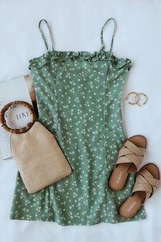 A mint green floral sundress, bamboo bag, raffia slide sandals, and gold hoops make for the cutest spring outfit. These spring essentials transition into summer seamlessly. #lovelulus