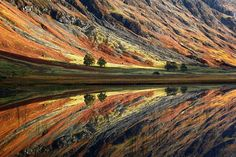 Incredibly calm lake in Glen Coe, Scotland. Glen Coe Mirror by Michal Vitasek One Of the best photos I've ever seen.