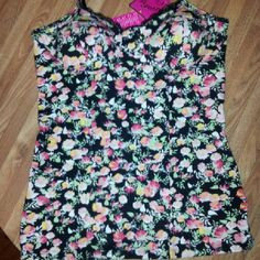 Candie's NWT Small Flower tank with built in bra This fun little piece has a built in bra for comfort and convenience. Would look cute with jeans or dressed up with a skirt. Candie's Tops Tank Tops
