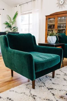 green velvet chairs with a mid century modern lines