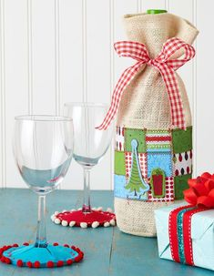A bottle of wine is always a thoughtful gift, but you can personalize it by  enclosing it in an embellished bag.