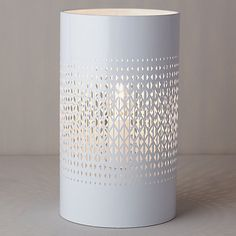 This striking table lamp has a geometric-shaped cutout design that will emit a decadent pattern of light when lit from within.
