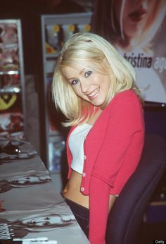 Christina Aguilera...I am in love with her blonde hair in this pic. So pretty