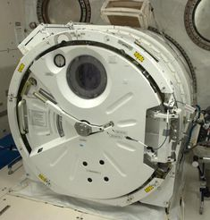 Chris Hadfield photographs from the International Space Station an airlock in the Japanese Lab to al...