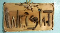 Driftwood letters WRIGHT with rope and sea shell border.