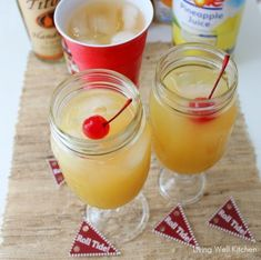 "Yellow Hammer Bama ""game day"" drink. Vodka, rum, amaretto, orange, pineapple, cherry on top."