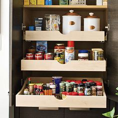 Pull-out shelves in the lower section of the pantry prevent smaller items, such as spices and condiments, from getting lost.