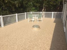 """In NW Washington DC, a leaky roof and worn out wood decking and railings were replaced with a new Duradek PVC walkable membrane in the Macchiato color and Durarail aluminum railing system using 4 inch posts & 1-1/2"""" slat pickets."""