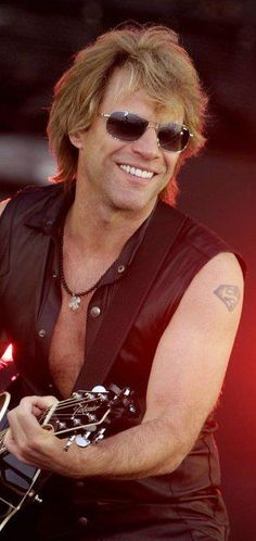Jon Bonjovi     meet him in person....I promise to be good....not!