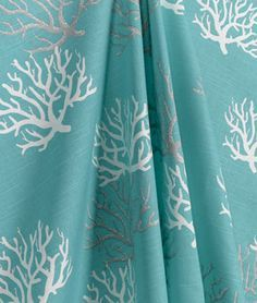 Premier Prints Isadella Coastal Blue Slub Fabric with a coral print in white, aqua blue and grey.