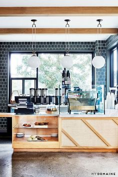 Well-designed Los Angeles brunch spot with dark blue tiled walls, exposed wooden ceiling beams, low-hanging pendant lights and a coffee bar Cafe Interior, Kitchen Interior, Kitchen Design, Kitchen Decor, Hotel Restaurant, Restaurant Design, Restaurant Counter, Restaurant Lighting, Restaurant Interiors