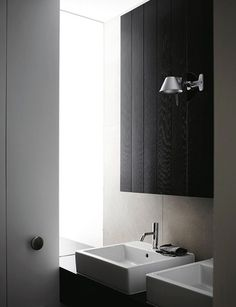 The bathroom design elements work in harmony with the rest of the apartment.