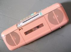 @Melissa Clark Speaking of cassette tapes, E just HAD to have this pink boombox he saw at a garage sale this summer.  He's having a blast playing tapes are recording on it! (I totally had this little boom box in Jr. High!)