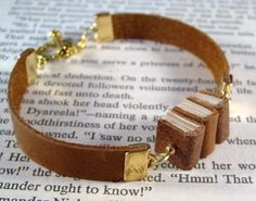 (Reserved for Jboll5) Miniature Book Bracelet by JanDaJewelry. $40 Lots of other awesome book jewelry here as well!