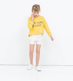 Image 1 de SHORT AVEC PONT À BOUTONS-PRESSION de Zara