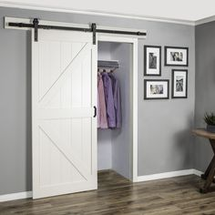 Start the New Year on-trend a with a sliding barn door for your closet. Click this pin to shop the DIY door kit.