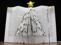 DIY book Christmas tree decorations by Kimbrough Library Book Christmas Tree, Book Tree, Holiday Tree, Xmas Tree, All Things Christmas, Christmas Tree Ornaments, Christmas Crafts, Merry Christmas, Christmas Displays