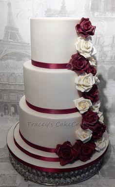 3 tier wedding cake with cascade of handmade gum paste roses