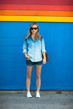 Ombre chambray button-down shirt + dark denim cutoffs + converse sneakers.
