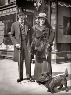 An elegant couple out for a stroll with their Scottie in Washington, D.C. in 1917.