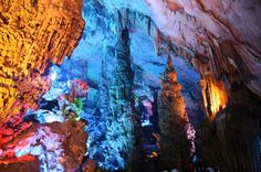 Reed Flute Caves, China The surreal qualities of this cave have a lot to do with the artificial lighting, but the natural limestone is over 180 million years old and is filled with many strange and surreal shapes.