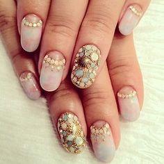 shell and crystal nail art