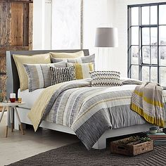 Add chic sophistication to your bedroom with the KAS ROOM Logan Duvet Cover. Adorned with a simplistic linear design in grey, white and yellow hues, the stylish bedding instantly brings an urbane look and feel to any room's décor.