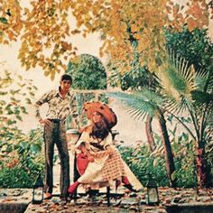 Paul Getty, Jr. & his worldly wife Talitha Pol (born in Bali, brought-up in Indonesia and the Netherlands, and member of English painter Augustus John's family circle) pose artfully on a raised walk at their 19th-century Marrakech holiday house. Photograph - Patrick Lichfield, 1970. #patricklichfield