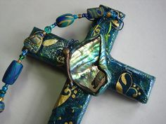 Paua shell & polymer clay butterfly on collage cross made by Nancy Denmark & Patti Reed. #butterfly #polymerclay
