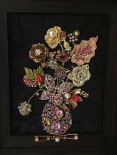 Jewelry collage wall frame by HOMEOFTHERHINESTONE on Etsy