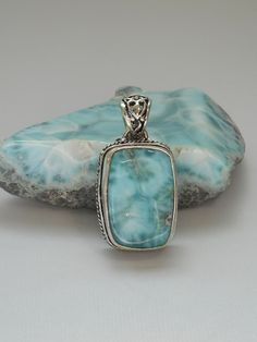 "Hand-scrolled artisan rectangle polished cabachon Caribbean Larimar gemstone pendant, bezel-set in 925-hallmarked sterling silver with intricate scrollwork setting and bail. Length: 1.6"" Width: 1"""