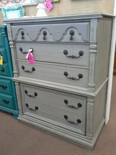 SOLD - This is a tall five-drawer dresser that has been painted grey distressed and finished with a dark wax. It has the original matching metal hardware. The chest measures 40 inches across the front, 19 inches deep and it stands 49 inches tall. It can be seen in booth A8 at Main Street Antique Mall 7260 East Main St ( E of Power Rd ) Mesa 85207  480 9241122open 7 days 10 till 530 Cash or charge 30 day layaway also available
