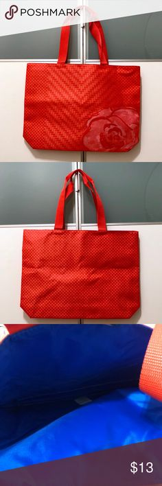 "Lancome Red Large Tote Bag -Lancome Red Large Tote Bag GWP -Red/Coral bag with rose on bottom right, inside is bright blue.  -Measurements: 13"" H (22"" with handles) x 17 1/2"" W x 3 1/2"" D & 9"" handle drop. —————————————————— ❌NO TRADING  🥇POSH AMBASSADOR  📦FAST SHIPPER 🔝 RATED SELLER  🔝10% SELLER🏆 🛍 BOUTIQUE CERTIFIED  💌TAKE A LOOK AT MY FEEDBACK Lancome Bags Totes"