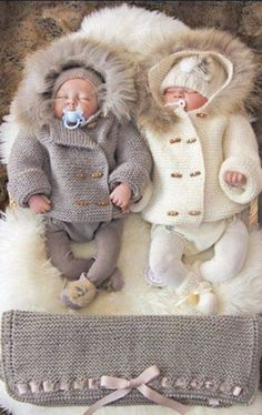 Cute babies in coats