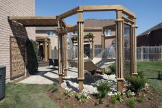 """The variety of aerial features in this back yard help to make the deck feel like a natural extension of the home, and create a sense of separation and privacy from the nearby neighbours.  From """"Decked Out"""" project """"The Hammock Deck"""".  Deck Design by Paul Lafrance Design."""