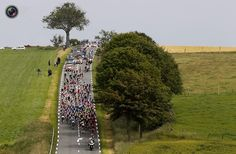 The pack of riders cycles during the third stage of the 99th Tour de France cycling race between Orchies and Boulogne sur mer. BOGDAN CRISTEL/REUTERS