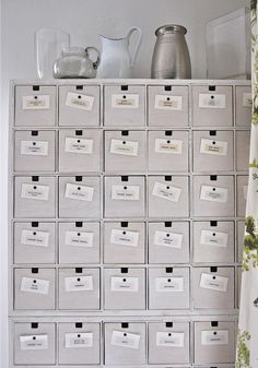 Wooden Ikea CD drawers come in sets of two, white washed and used to create a wall of drawers