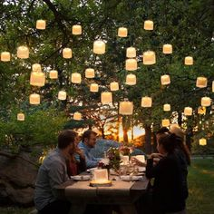 A backyard glittering with string lights and Sonnenglas makes a magical and intimate space for outdoor lounging! Click through to learn more about our handcrafted solar lanterns and get some to illuminate your own outdoor space ✨ (Photo by Restaurant En Plein Air, Outdoor Restaurant, Solar Lantern Lights, Solar Lamp, Backyard Lighting, Outdoor Lighting, Lighting Ideas, Backyard Trees, Backyard Patio