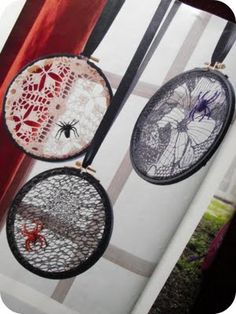 "I had found this in a ""Women's Day"" magizine special issue....simple to make. Take embroidery hoops, paint black, place lace or doilies (paint black w/ spray paint if desired) between hoop parts, hot glue spiders on and hang w/ black satin ribbon or yarn. Easy peasy!!!"