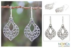 Sterling silver tendrils swirl in graceful filigree petals on a pair of handcrafted earrings. Enchantingly feminine, they distinguish earrings from Aoy in Thailand.