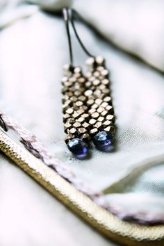 A cascade of brass ends in shimmering iolite gems. Pretty!